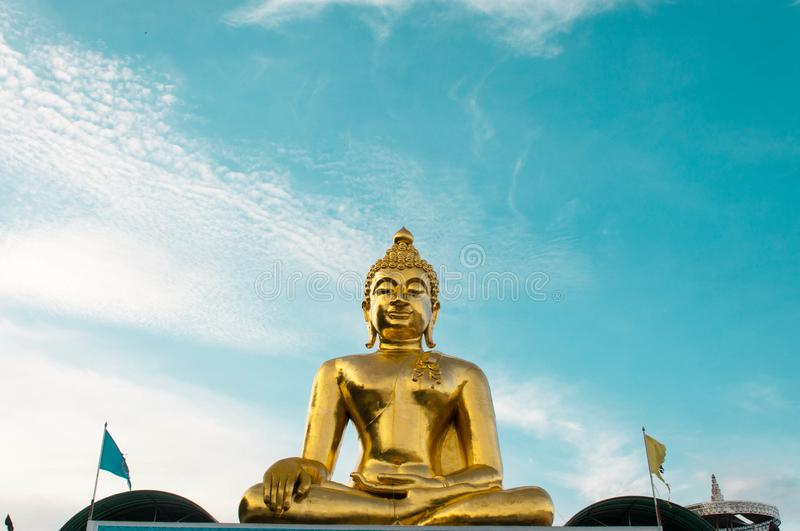 Giant Golden Buddha statue with blue sky Thailand stock image