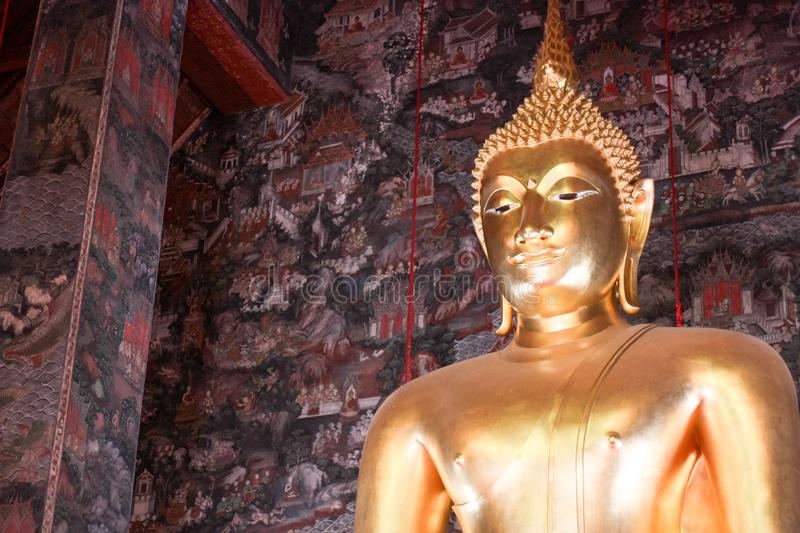 Giant golden Buddha statue front Thai acient art living style in Buddhist temple., Bangkok, Thailand royalty free stock images