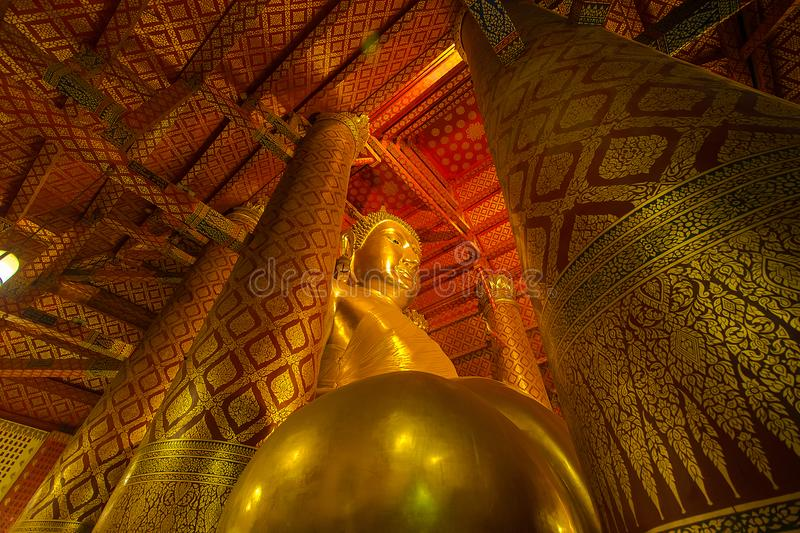 Giant golden Buddha in Wat Phanan Choeng Temple in Ayutthaya, Th royalty free stock photography