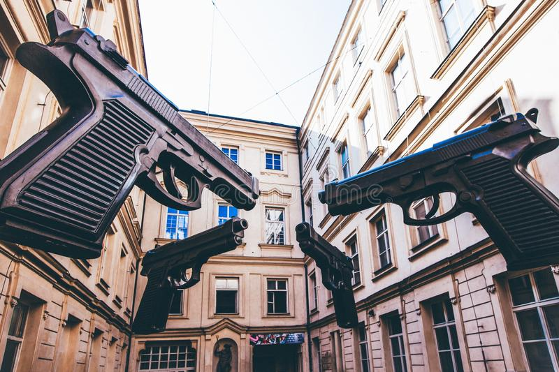 Giant guns in the middle of buildings of Artbanka Museum of Art Young in Prague, Czech Republic. A closeup shot of giant guns in the middle of buildings of royalty free stock image