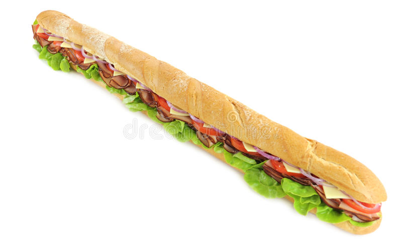 Giant Ham And Salad Sub. Giant ham, tomato, lettuce, cheese and onion sub ready to serve stock photography