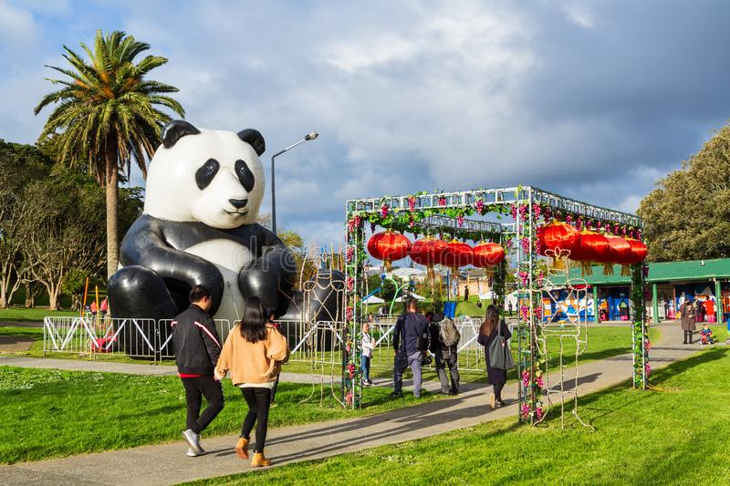 Giant inflatable panda and Chinese lanterns at moon festival celebrations royalty free stock images