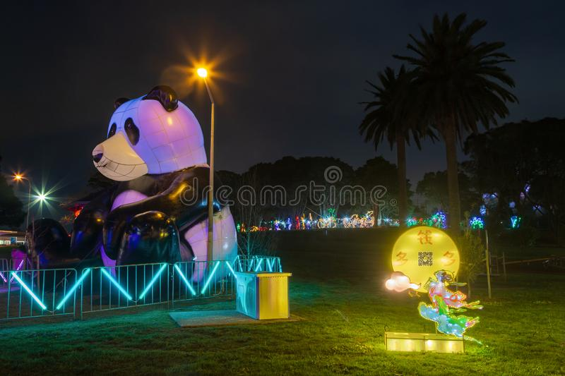 Giant inflatable panda and Chinese moon goddess decorations in park for moon festival stock photography