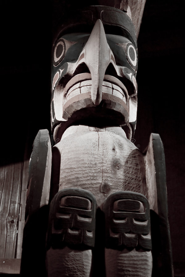 Giant Inuit Totem. A huge carved wooden totem by Inuit Indians in Alaska royalty free stock photos
