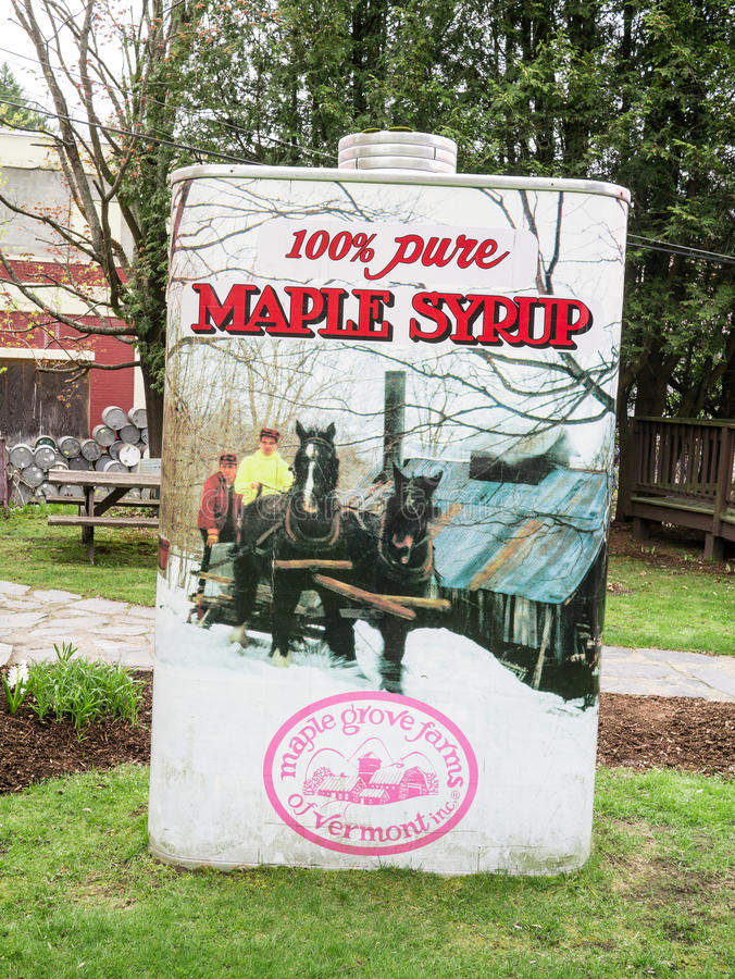 Giant Maple Syrup - St. Johnsbury Vermont. A Paul Bunyan sized container of 100% pure Vermont Maple Syrup marks the entrance to the Maple Syrup Museum and Gift royalty free stock photos