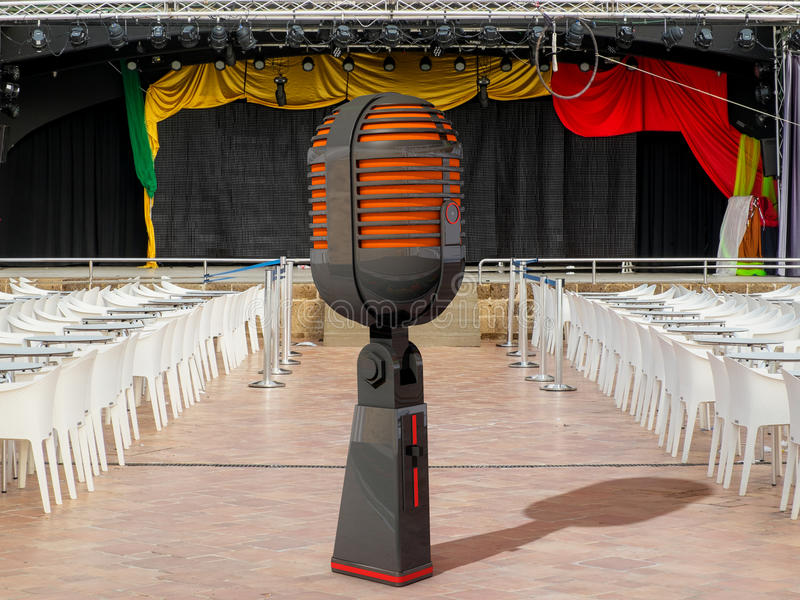 Giant microphone and stand. Giant microphone and real stand royalty free stock photography
