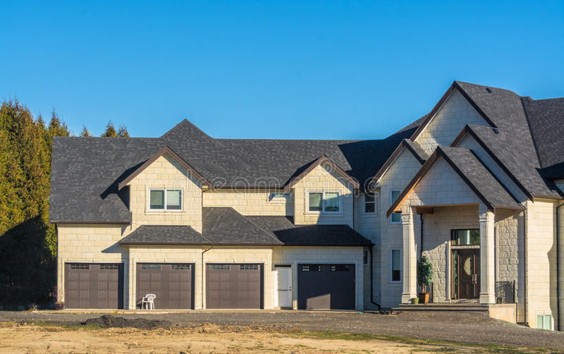 Giant new residential house with four stall garage stock photos