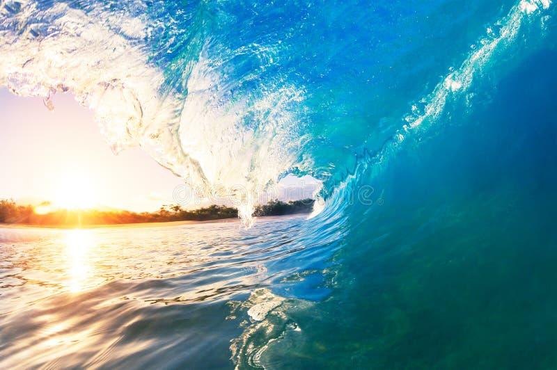 A Giant ocean wave tube. Big Ocean Wave at Sunrise stock photo