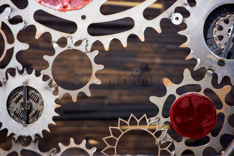 GIANT OLD AND RUSTY COGWHEELS WITH WOODEN BACKGROUND. GIANT OLD AND RUSTY COGWHEELS WITH WOOD BACKGROUND stock image