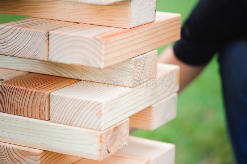 Giant Outdoor Block Game. The tower from wooden blocks. Giant Outdoor Block Game. The tower from wooden blocks stock photography