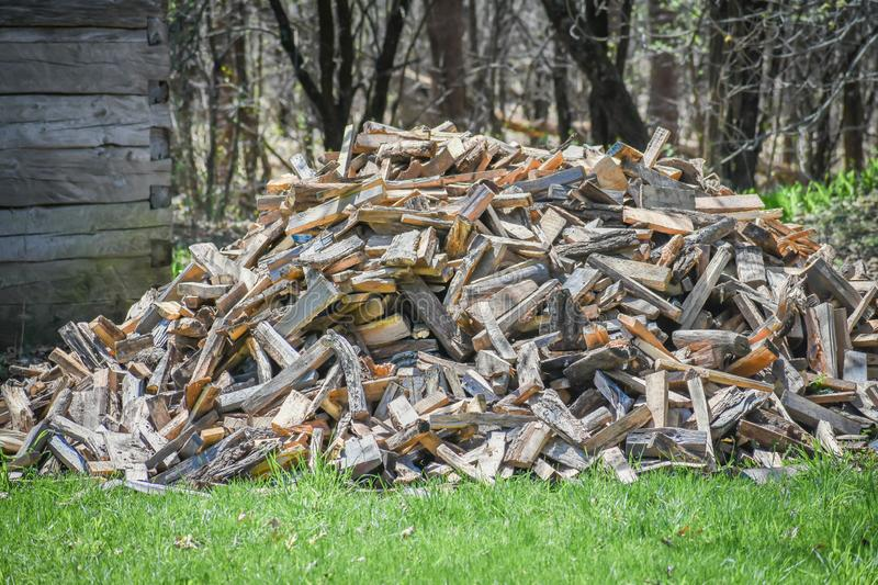 Giant Outdoor Wood Pile of Chopped Wood. A giant outdoor wood pile of freshly chopped wood from fallen trees stock photos