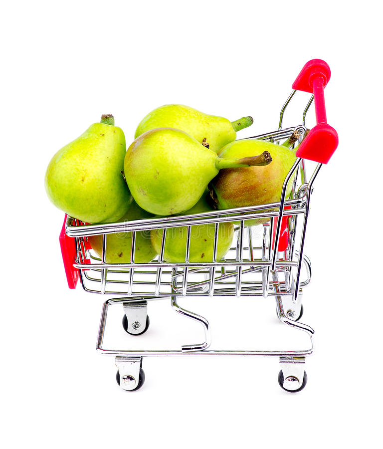 Giant paradise pears in mini shopping cart. Detailed studio shot royalty free stock images