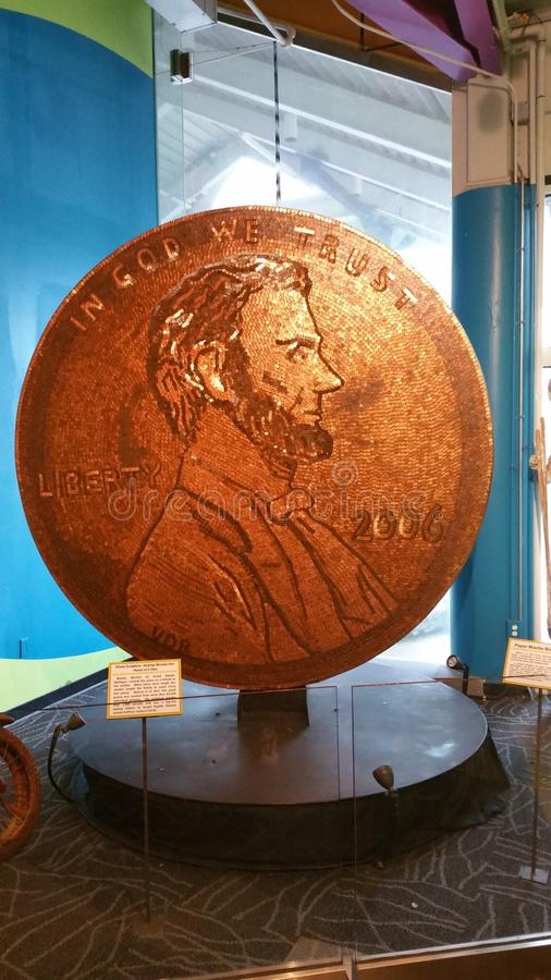 Giant penny made out of pennies royalty free stock photos