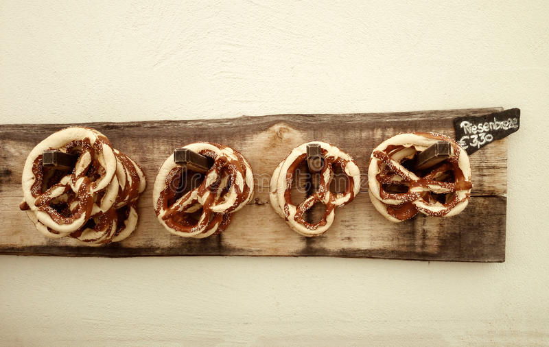 Giant pretzel on board for sale. Soft focus stock photography