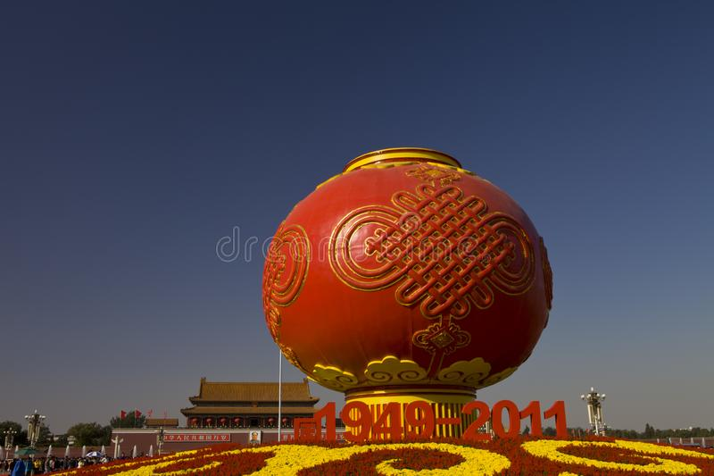Giant red lanterns at tian `anmen square in Beijing. The giant red lanterns stand out in Beijing`s tian `anmen square, with the tian `anmen rostrum in the stock photos
