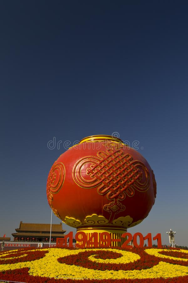 Giant red lanterns at tian `anmen square in Beijing. The giant red lanterns stand out in Beijing`s tian `anmen square, with the tian `anmen rostrum in the stock photography