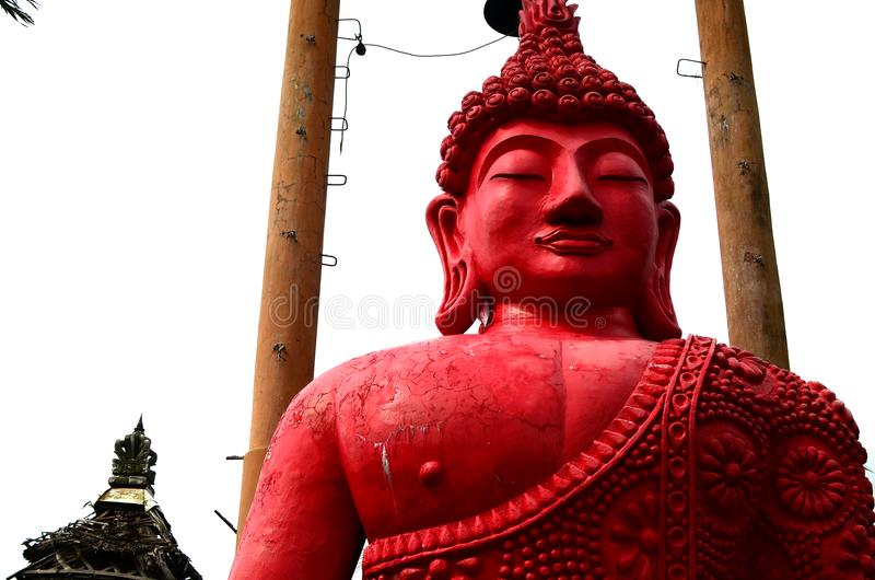 Giant red stone buddha decorates an Asian aquatic jungle theme park stock images