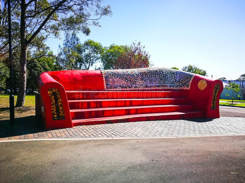 Giant Red stone sofa for park decoration. stock photos