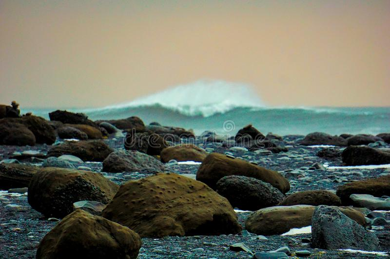 Giant Rocks With Smashing Waves In The Background At Reynisfjara Beach In Iceland royalty free stock photography