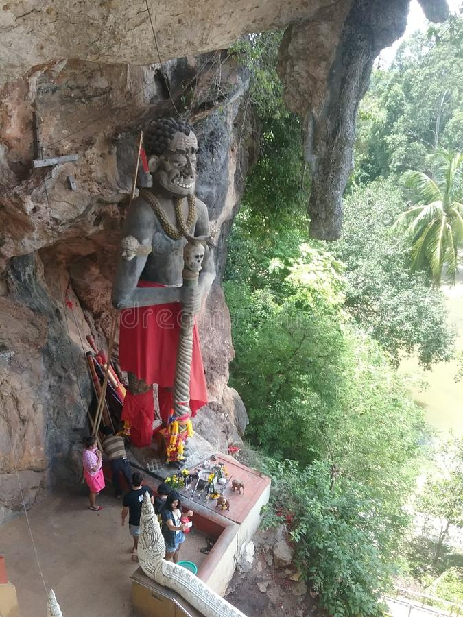 The Giant of Buddhism. Giant round relief stand in front of cave Wat Kuhapimuk Temple stock images
