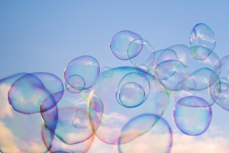 Giant soap bubbles floating in the air royalty free stock photos