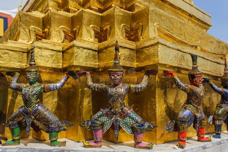 Giant stand around pagoda of thailand at wat prakaew stock photo