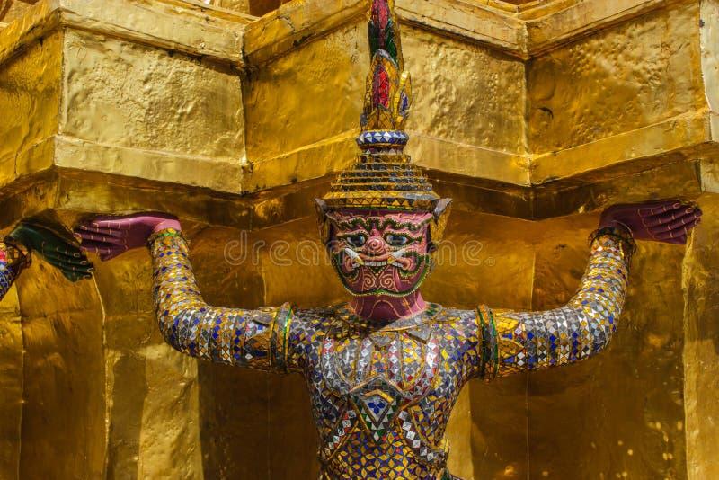 Giant stand around pagoda of thailand at wat prakaew royalty free stock photography