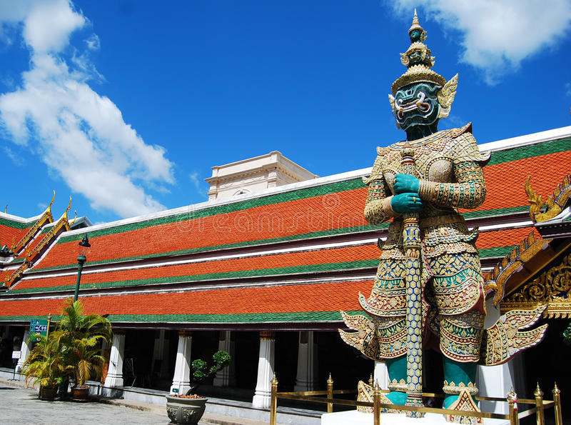 The giant stand on sentry bankok thailand. The giant stand on sentry in front of royal temple palace stock photos