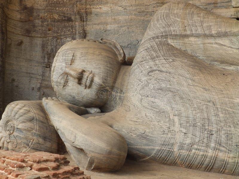 Giant statue of sleeping Buddha. Sri Lanka royalty free stock images