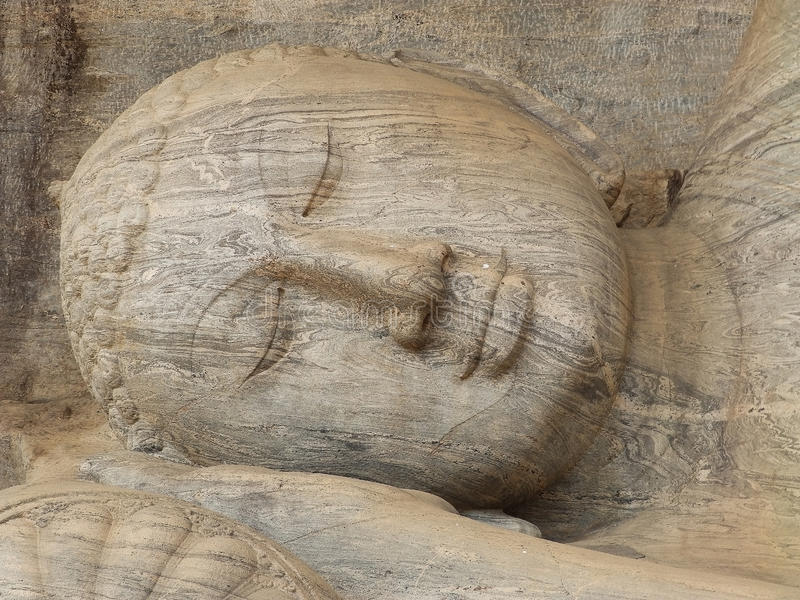 Giant statue of sleeping Buddha. Sri Lanka stock photo