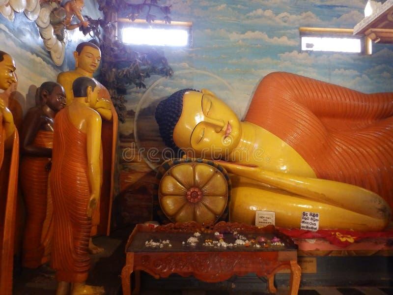 Giant statue of sleeping Buddha in Sri Lanka stock images