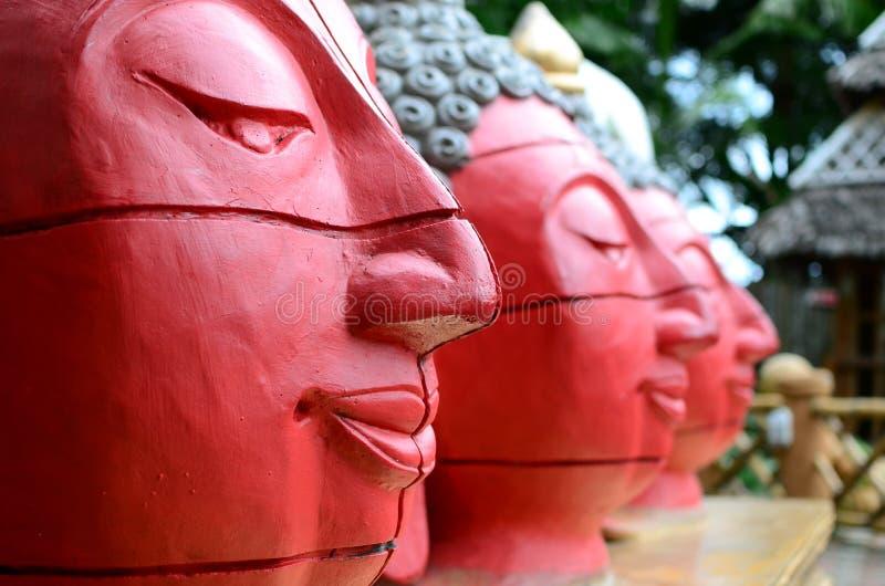 Giant stone buddha decorates an Asian aquatic jungle theme park stock photos