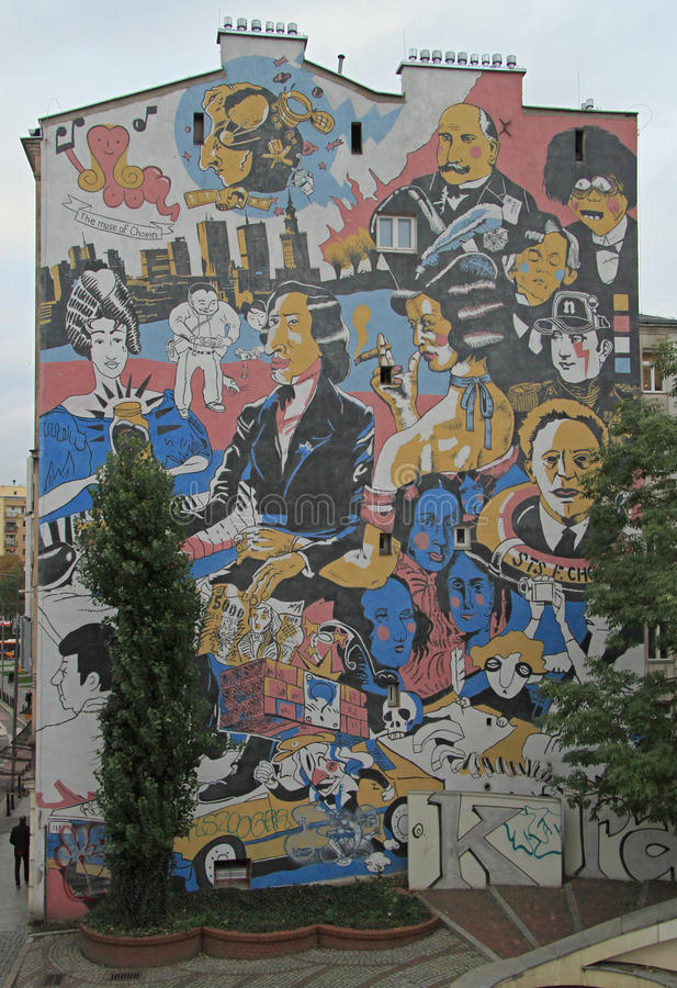 Giant street art murals on building walls in Warsaw, Poland. stock photos