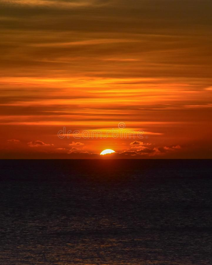 Giant Sun setting into the South Pacific Ocean royalty free stock photos