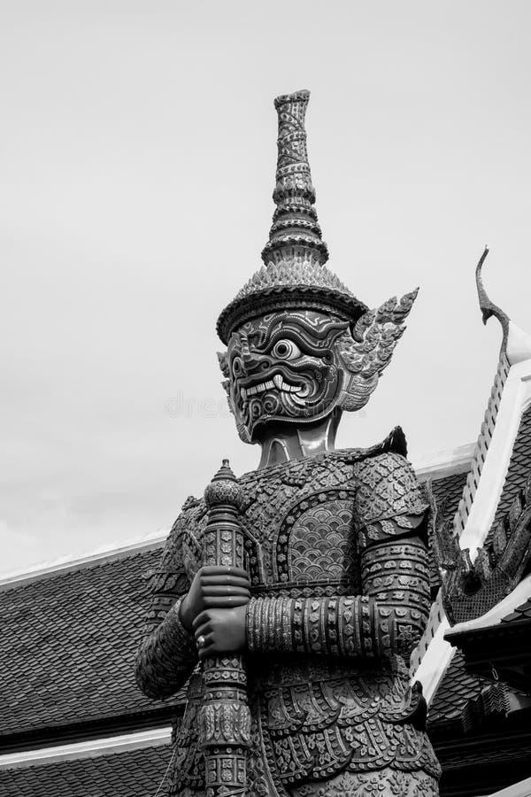 Giant of Wat Phra Kaew or Grand Palace, Bangkok, Thailand. Giant of Thailand stand in the Grand Palace Black & White stock photo