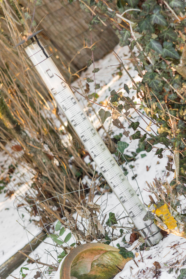Download Giant Thermometer Outside In A Garden At A Winter Day With Snow  Stock Photo