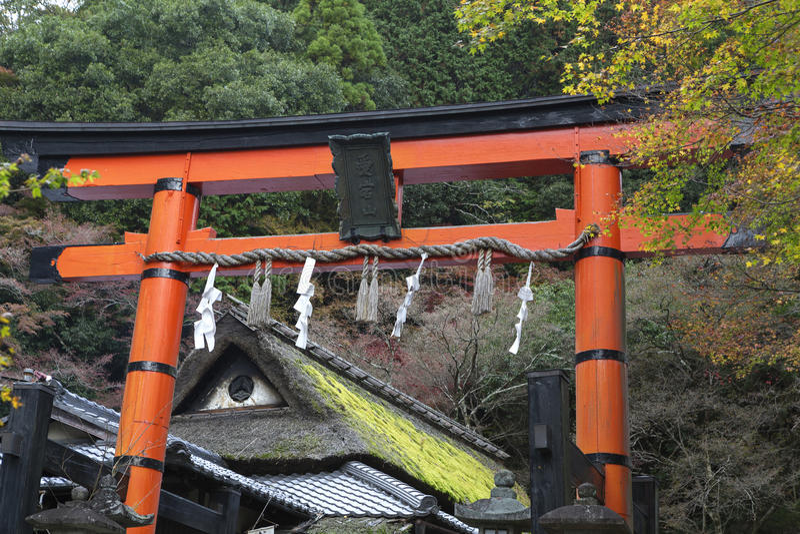 Giant torii gate at Shinto shrine in autumn. Arashiyama, Kyoto, Japan stock photos