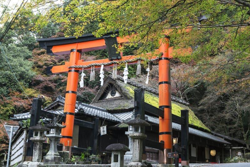 Giant torii gate at Shinto shrine in autumn. Arashiyama, Kyoto, Japan stock photography