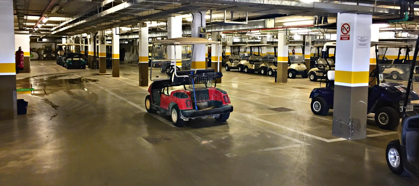 Underground golf buggy parking in Spain royalty free stock photos