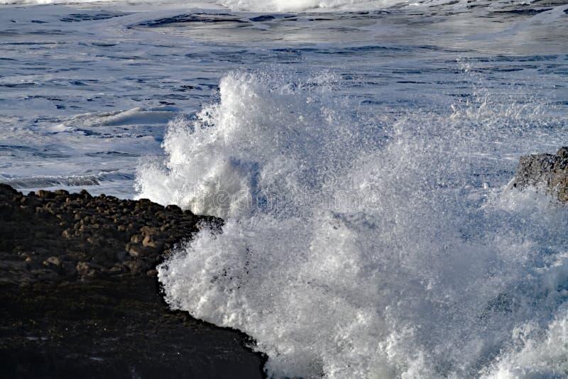 Giant Waves crashing on Rocks stock photo