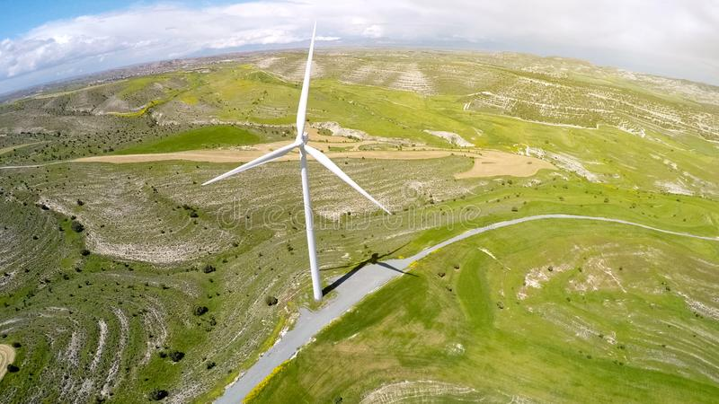 Giant wind turbine supplying alternative green energy, located in countryside stock photo