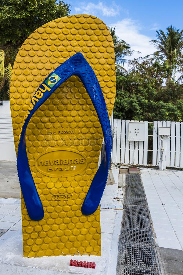 Giant yellow and blue slipper with Brazil flag at Baisha Beach stock photo