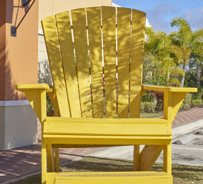 Giant yellow wooden chair stock photo
