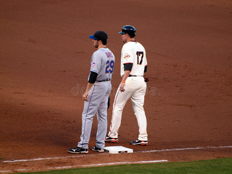 Giants Aubrey Huff begins to take lead from 1st. SAN FRANCISCO, CA - JULY 17: Giants Aubrey Huff begins to take lead from 1st base next to Mets Ike Davis at ATT royalty free stock photography