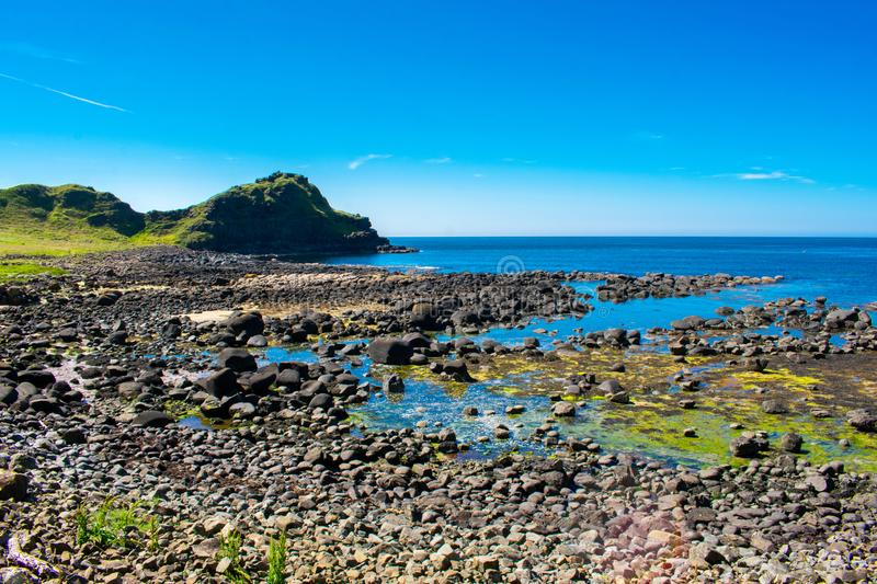Giants Causeway on Coast of Atlantic Ocean in Northern Ireland. Beautiful landscape, summer time royalty free stock photos