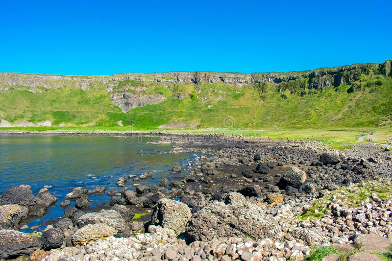 Giants Causeway on Coast of Atlantic Ocean in Northern Ireland. Beautiful landscape, summer time royalty free stock image