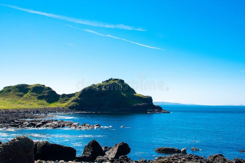 Giants Causeway on Coast of Atlantic Ocean in Northern Ireland. Beautiful landscape, summer time stock photos