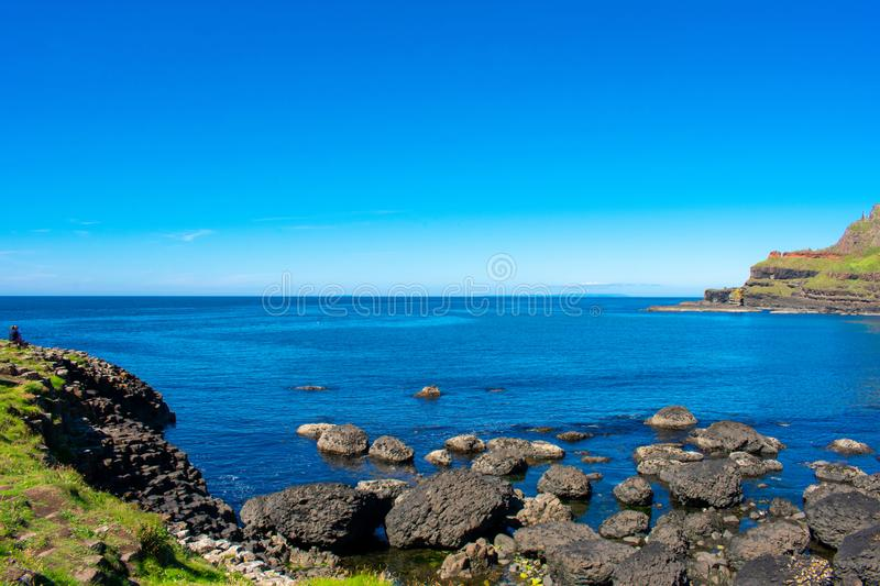 Giants Causeway on Coast of Atlantic Ocean in Northern Ireland. Beautiful landscape, summer time stock images