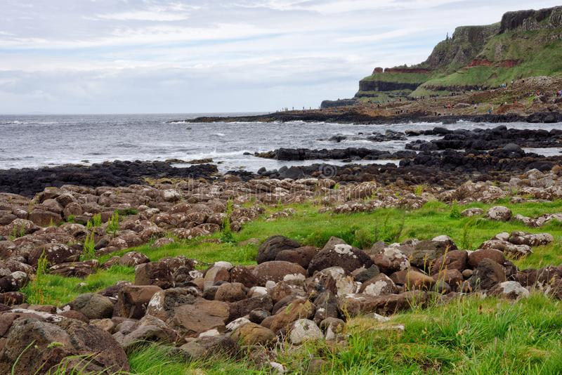 Giants Causeway in Northern Ireland United Kingdom. The rolling hills and the Atlantic Ocean at the Giants Causeway in Northern Ireland United Kingdom near the stock photos