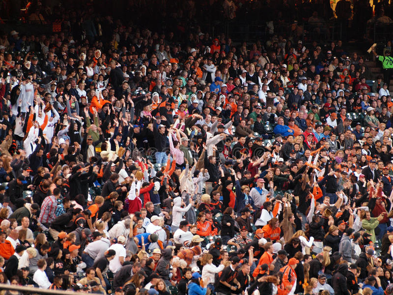 Giants fans do the wave during the late innings. San Francisco Giants Vs. New York Mets: San Francisco Giants fans do the wave during the late innings to stay royalty free stock photography